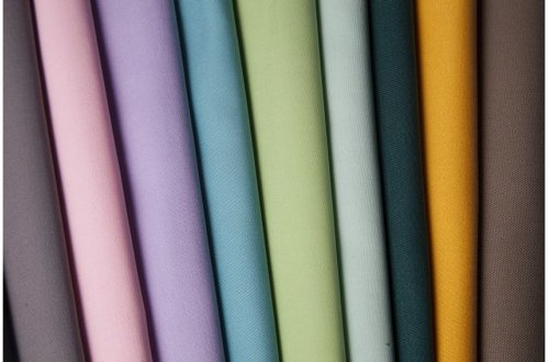©2019 Klopman International. Some of the colorful fabrics the mill produces for workwear, protectivewear and corporatewear.