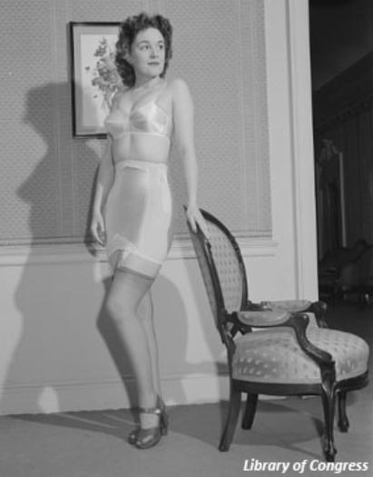 A young woman models an uncomfortable girdle and brassiere made before the invention of LYCRA® fiber in 1958.