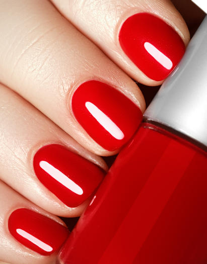 Finger nails with red nail polish made with a liquid form of LYCRA® fiber is more duarable and can last up to 10 days.