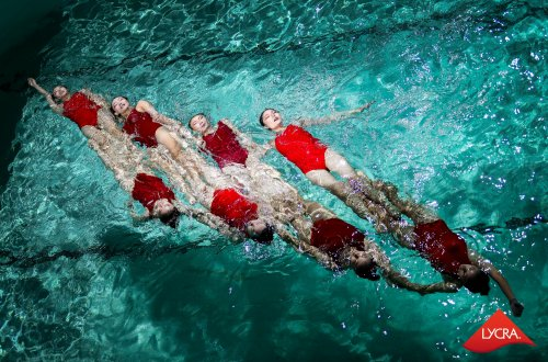 Synchronized swimmers wearing swimsuits with LYCRA® lastingFIT technology at The LYCRA Company's annual consumer event.